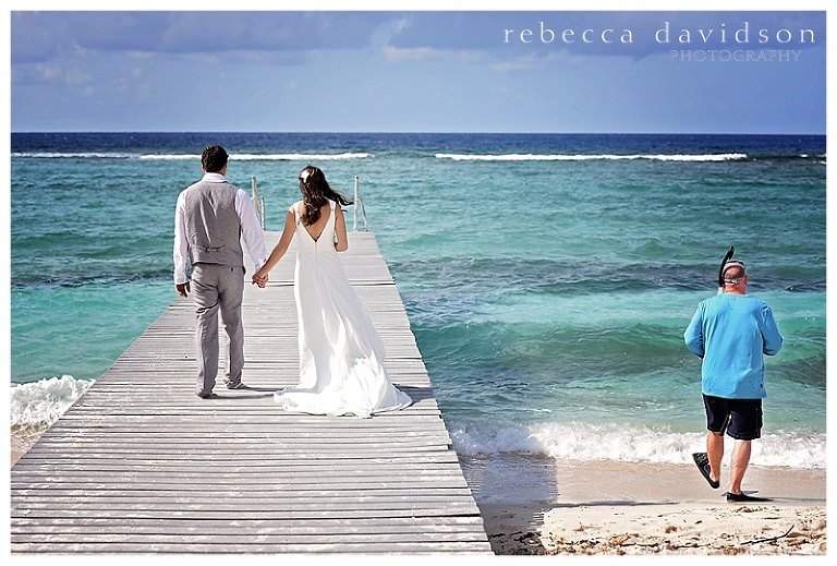 Fun Shot Of Bride And Groom On Dock With Snorkeling Guy Wedding