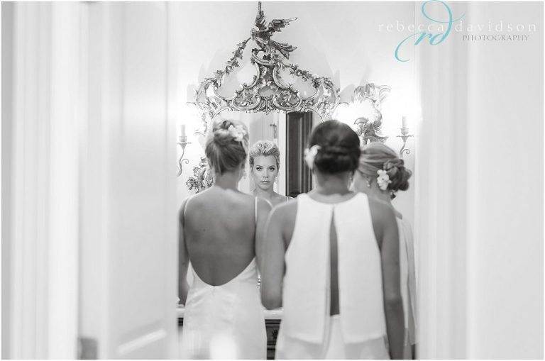 getting ready bridesmaids all white
