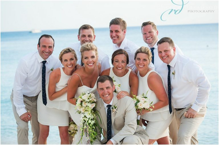 fun bridal party in all white at this cayman beach wedding