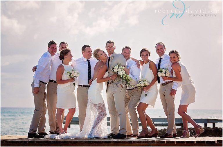 crazy bridal party on pier