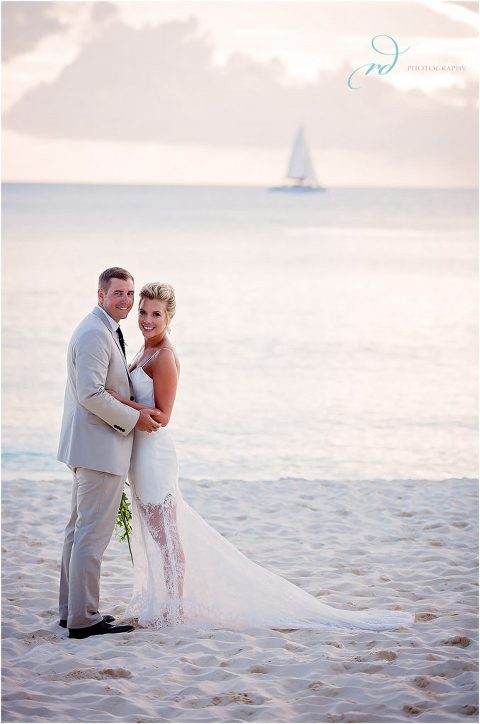 gorgeous bride and groom with sailboat