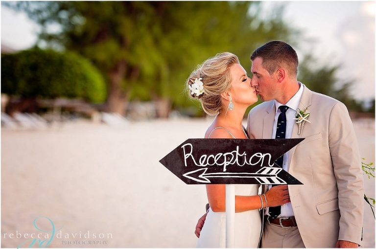 couple with reception sign