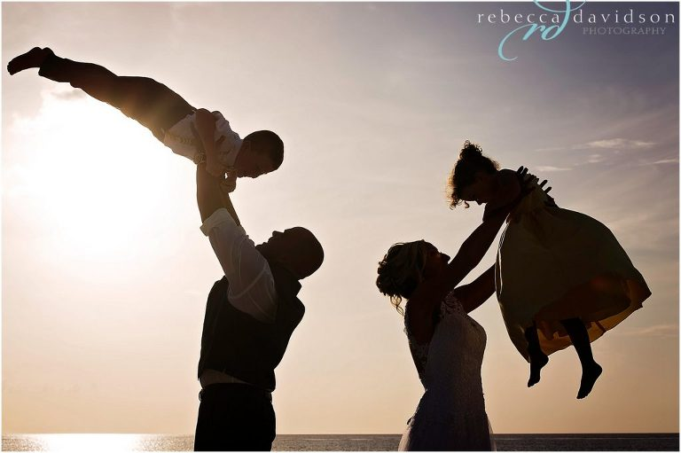 parents and kids swing in air silhouette