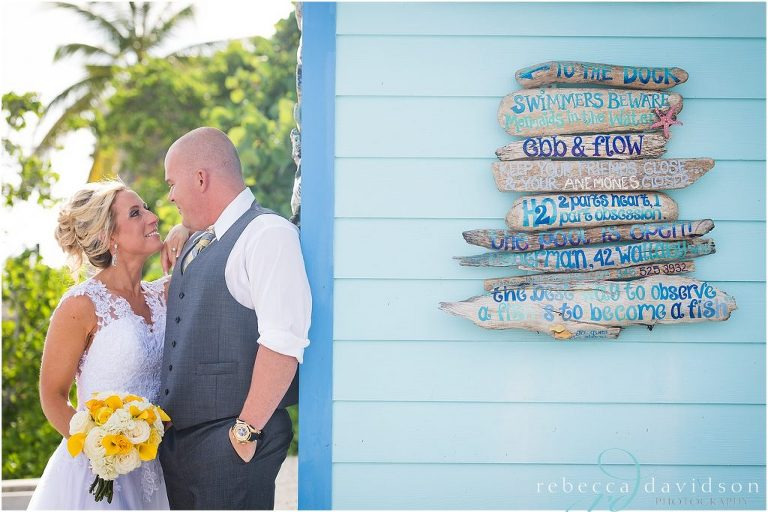 wedding_couple_by_blue_old_house