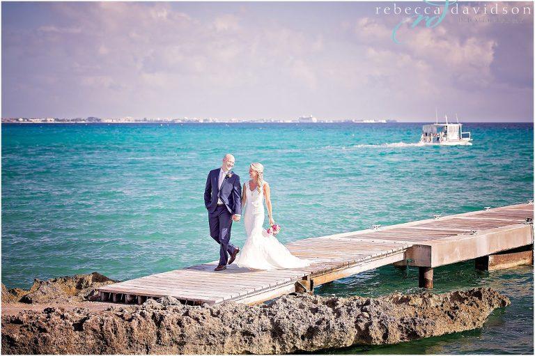 walking on dock with groom in navy blue suit