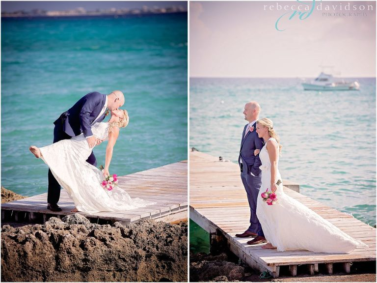 kissing on dock with navy blue suit