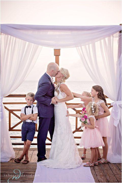 fun kissing shot of wedding at grand old house wedding