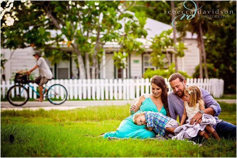 family in grass with old cayman house island bump session