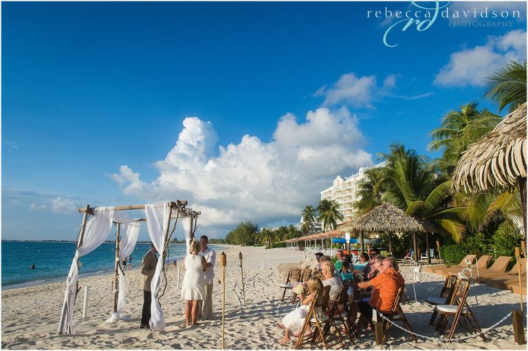 family on caribbean beach for wedding