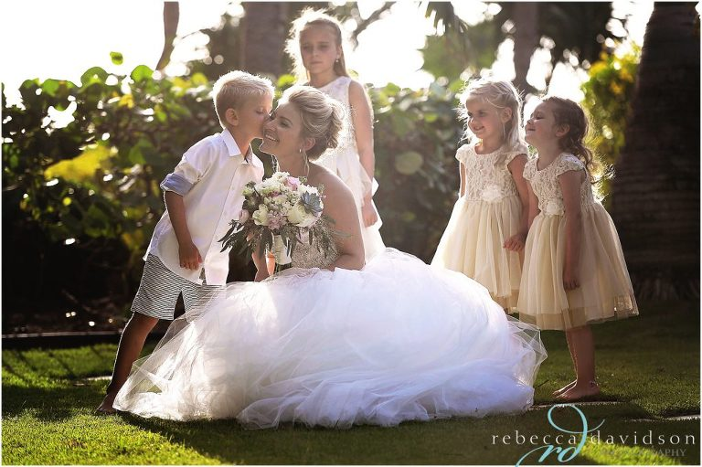 flower girls and ring bearer kiss bride