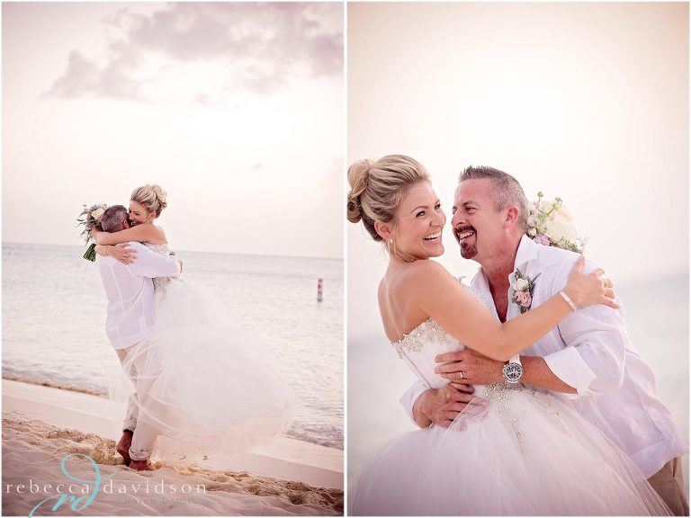bride and groom all white hug on beach