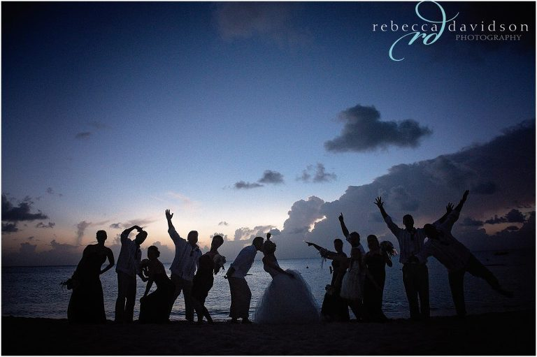 silhouette of bridal party on beach