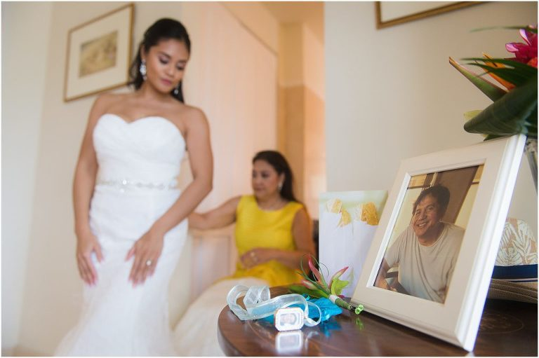 bride looking at picture of dad