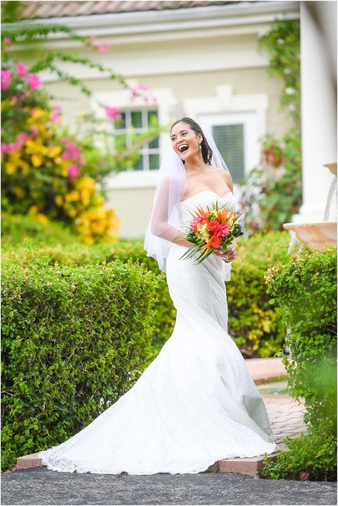 beautiful bride in garden laughing