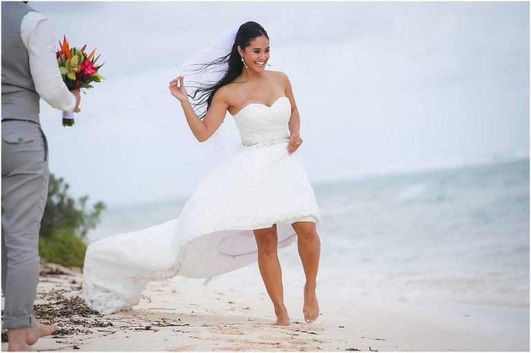 bride in water laughing